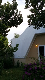 Part of the geodesic dome house. Could not get a great picture because of a large tree